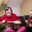 Two women make a music therapy — Stock Photo