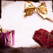 Festive background with heart and gift — Stock Photo