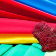 Colorful background of crepe paper and a heart — Stock Photo