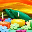 Colorful background of candles and crepe paper — Stock Photo