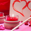 Stock Photo: Romantic pink background with red hearts