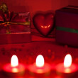 Red background with candles and heart — Stock fotografie