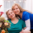 Mother and daughter in living room — Stock Photo