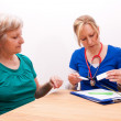 Stock Photo: Advising Senior on dose of medication