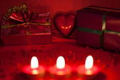 Red background with candles and heart — Stock Photo