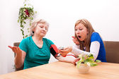 Nurse and patient are surprised by the blood pressure — Stock Photo