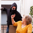 Perpetrators of violence, coat of female senior — Stock Photo