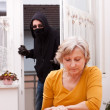 Burglar surprise unwary senior — Stock Photo