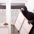Thief steals a painting — Stock Photo