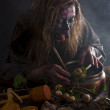 Herbalist brewing up a soup — Stock Photo