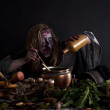 Witch brewing potion in laboratory — Stock Photo