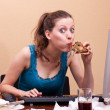 Pretty female student eats a piece of pizza — Stock Photo