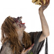 Stock Photo: Witch raises skull in air