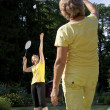 Family plays badminton in the garden — Stock Photo
