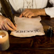 Man inscribed parchment — Stock Photo
