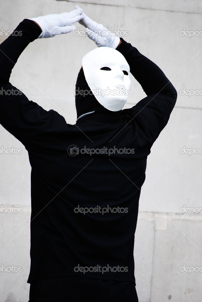 Man in black with white mask and gloves dancing   Stock Photo #13918512