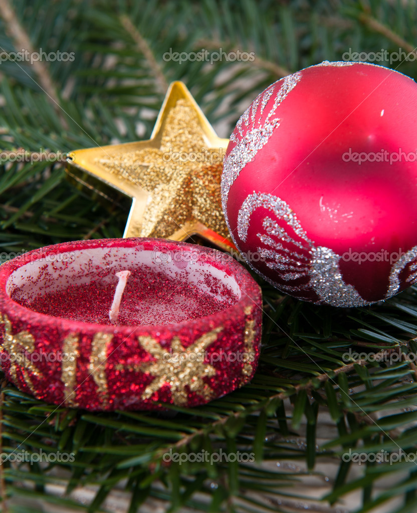 Red and golden christmas ornaments on pine needles — Stock Photo #16623953