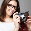 Retro photographer girl holding camera — Stock Photo