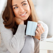 Attractive young woman drinking coffee at home — Stock Photo #14775959