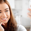 Pretty young woman using mobile phone — Stock Photo