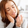 Foto Stock: Pretty young woman using mobile phone