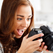 Foto de Stock  : Ecstatic photographer looking at photo