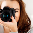 Pretty woman is a professional photographer with dslr camera — Stock Photo