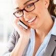 Attractive businesswoman using mobile phone — Foto de Stock