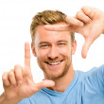 Happy man framing photograph — Stock Photo #14778939