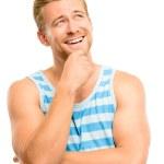 Joyful young man looking up thinking isolated on white backgroun — Stock Photo #14779317
