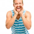 Attractive young man shouting - isolated on white background — Stock Photo