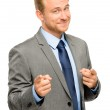 Happy businessman pointing on white background — Stock Photo