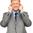 Worried young businessman suffering from headache — Stock Photo