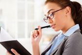 Attractive businesswoman preparing for a business meeting — Stock Photo