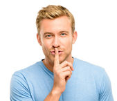 Sexy man with finger on lips — Stock Photo