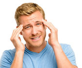 Worried young man suffering from headache — Stock Photo