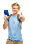 Uomo felice giovane turista tenendo passaporto pollici su bianco backgro — Foto Stock