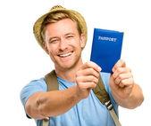Gelukkig jonge toeristische man met paspoort witte achtergrond — Stockfoto