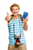 Happy tourist thumbs up passport retro camera isolated on white — Stock Photo