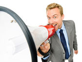Happy young bussinessman shouting with megaphone on white backgr — Stock Photo