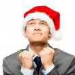 Mixed race businessman wearing santa christmas hat — Stock Photo