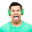 Crazy asian man pulling funny faces — Stock Photo