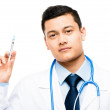 Confident happy Asian male doctor holding syringe — Stock Photo