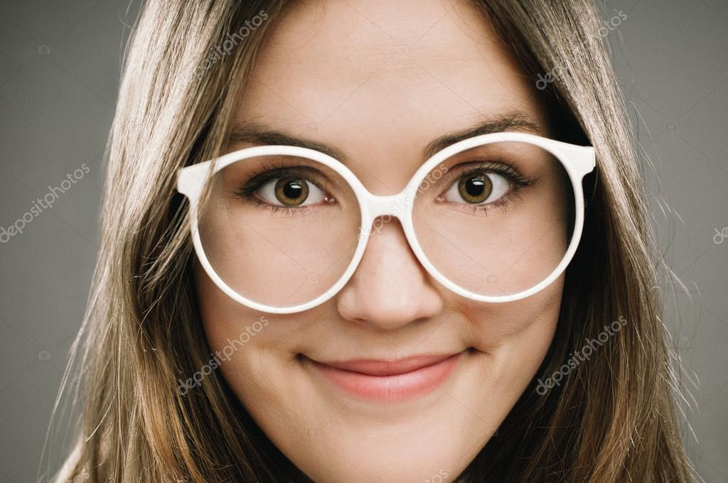 Retro Geek Girl wearing glasses grainy vintage portrait — Stock Photo #14782623