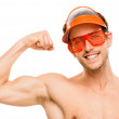 Attractive young man flexing bicep muscles — Stock Photo