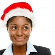 Cute African American businesswoman making a wish wearing Christmas hat — Stock Photo #14817619