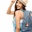 Pretty Indian woman tourist carrying backpack isolated on white — Stock Photo