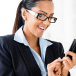 Closeup portrait of beuatiful indian businesswoman sending text — Stock Photo