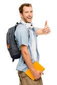 Mutlu genç erkek öğrenci yukarı işareti veriyor — Stok fotoğraf