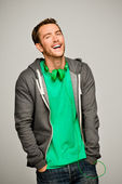 Attractive young man wearing hoodie smiling — Stock Photo